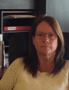 Karen Commandant, Administrator
